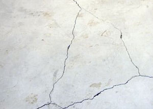 cracks in a slab floor consistent with slab heave in Bastrop.