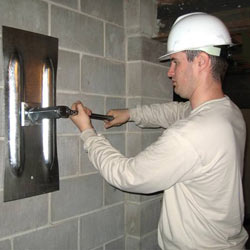 installing a wall anchor to repair an bowing foundation wall in Pineville