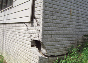 A severely damaged foundation wall in Natchitoches