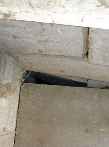 inward rotation of a foundation wall damaged by street creep in a garage in Leesville